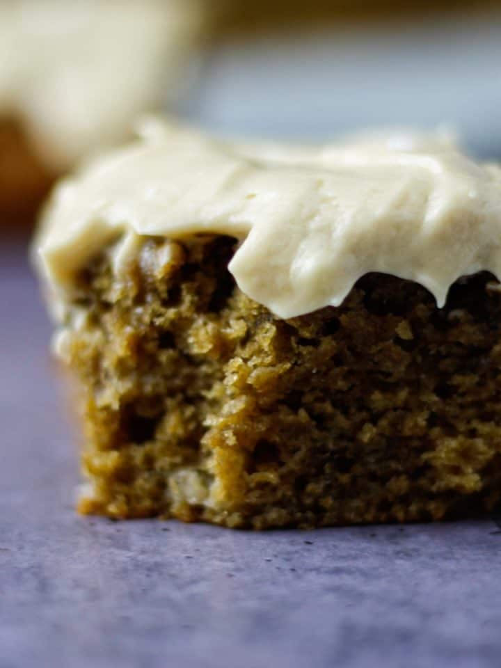 Up close view of a square piece of banana espresso coffee cake on table