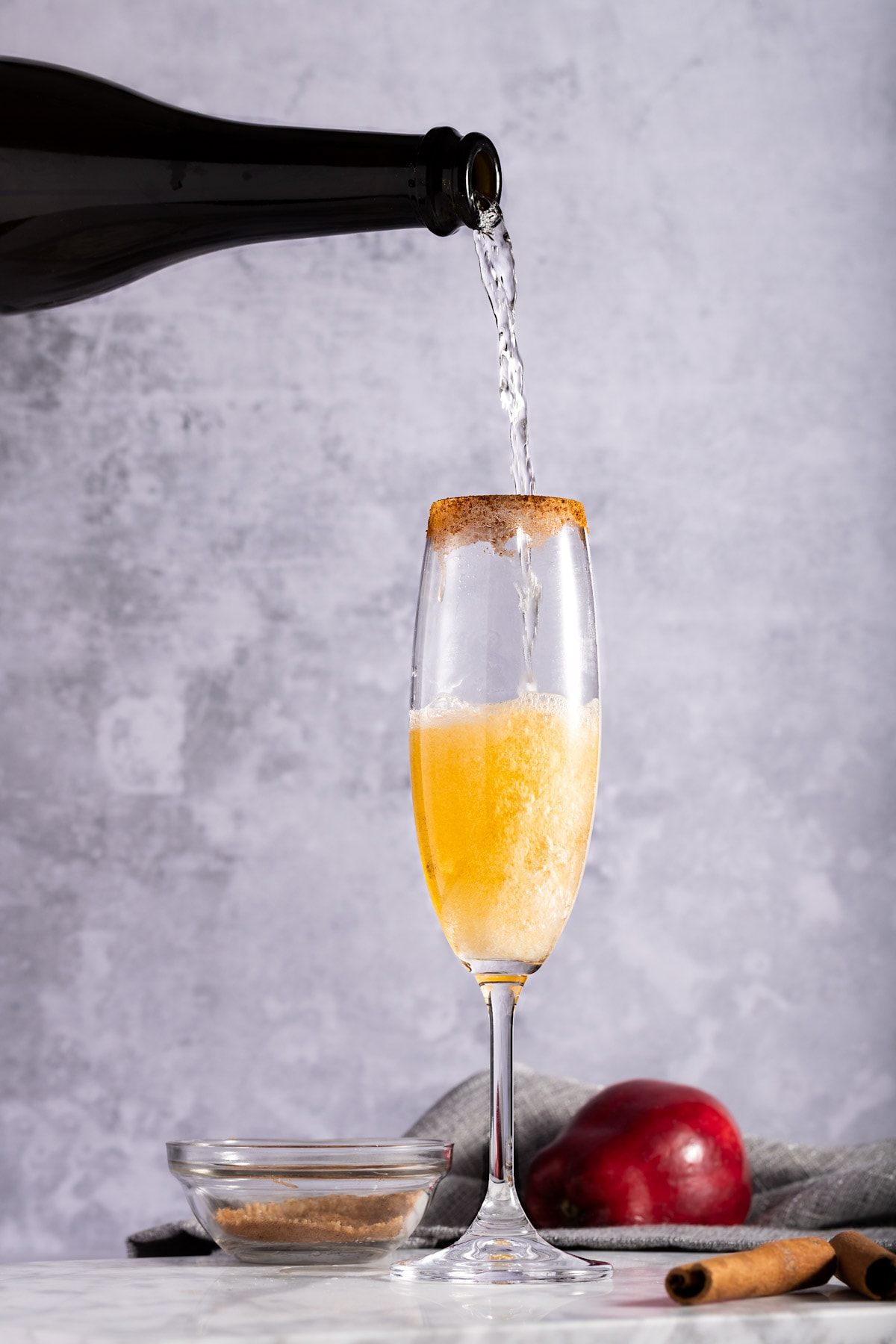Champagne being poured into the a mimosa glass.