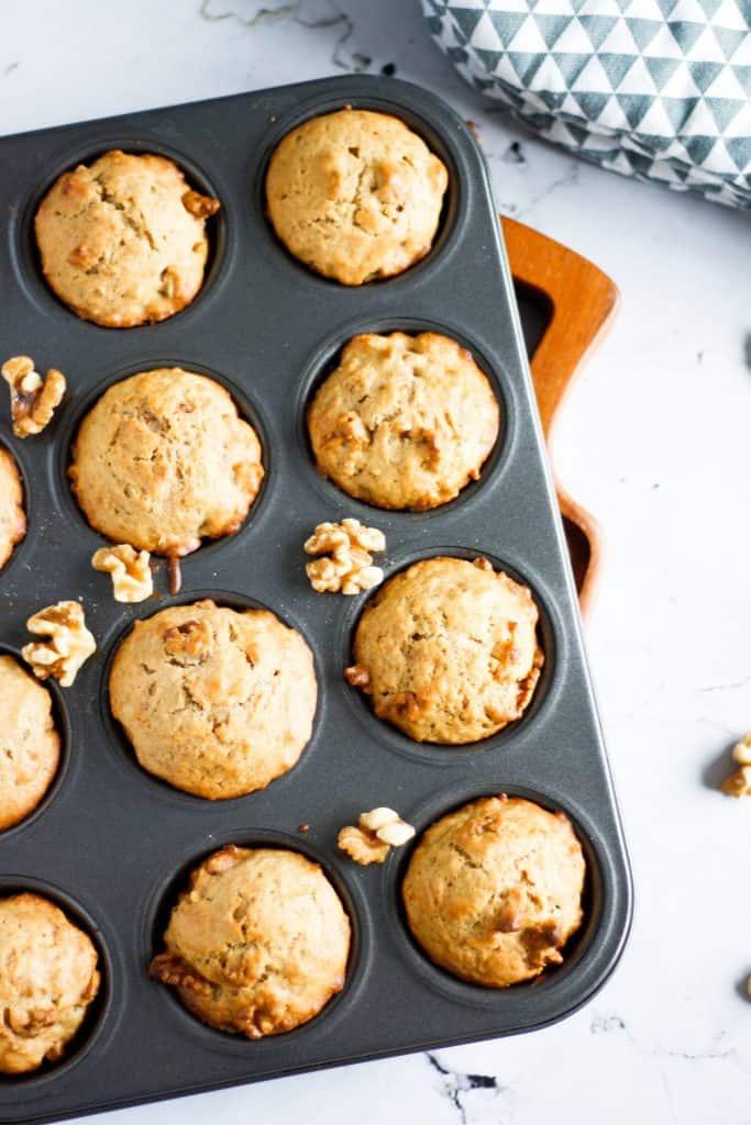 Muffin tin full of maple walnut muffins