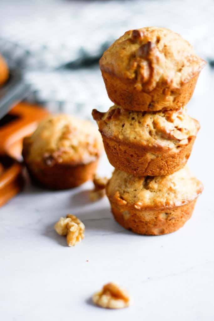 Three maple walnut muffins stacked on top of each other