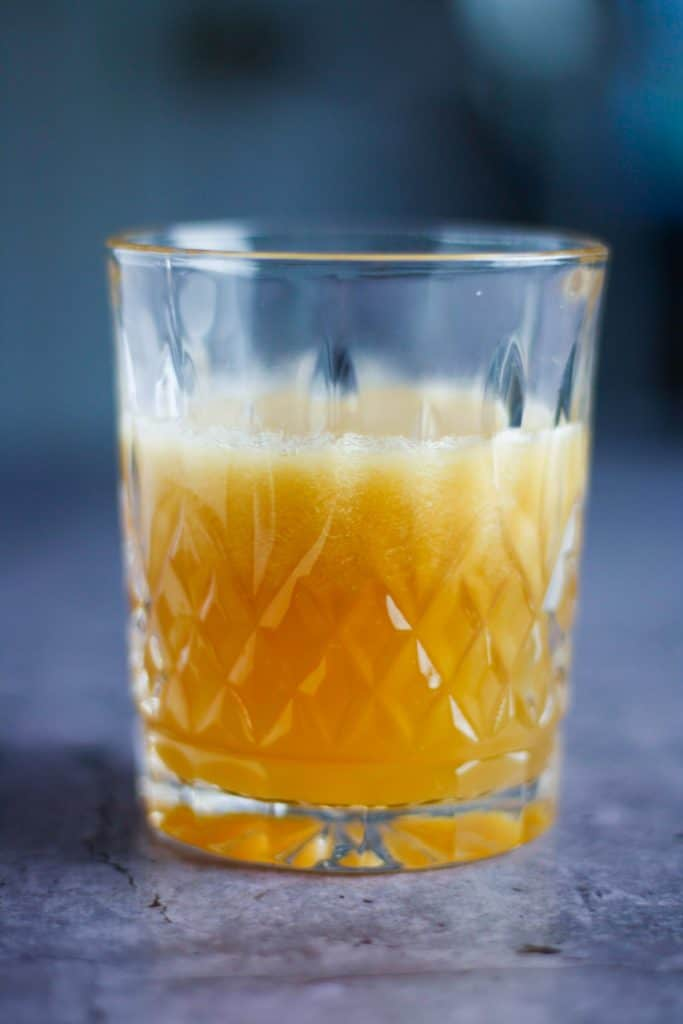 up close view of a glass of pear bourbon cocktail